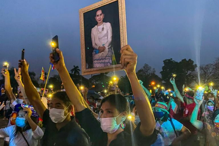 About 300 Myanmar citizens protested on Sunday in Thailand's northern city of Chiang Mai against a lack of global intervention