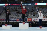From left to right, Yul Moldauer, Brody Malone and Sam Mikulak stand on their respective podiums after finishing in the top three positions during the U.S. Gymnastics Championships, Saturday, June 5, 2021, in Fort Worth, Texas. (AP Photo/Tony Gutierrez)