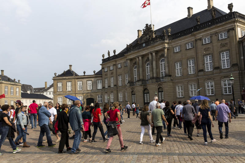 A large group of tourists walk towards Crown prince Frederiks and Crown Princess Marys residence, Frederik VIIIs palace at Amalienborg on August 28, 2019 in Copenhagen, Denmark. Amalienborg Palace is a complex of 4 palaces.