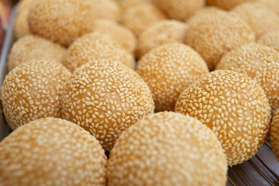 """Make these crisp, chewy sesame balls filled with sweetened red bean paste on the day you plan to eat them—they're just so much better fresh. <a href=""""https://www.epicurious.com/recipes/food/views/sesame-balls-104210?mbid=synd_yahoo_rss"""" rel=""""nofollow noopener"""" target=""""_blank"""" data-ylk=""""slk:See recipe."""" class=""""link rapid-noclick-resp"""">See recipe.</a>"""