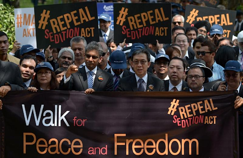 Malaysian lawyers march to the Parliament House in Kuala Lumpur during a rally to repeal the Sedition Act on October 16, 2014 (AFP Photo/Mohd Rasfan)