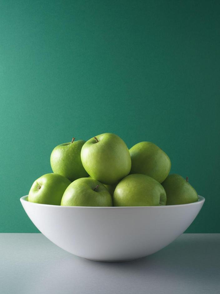 """<p>And set out a giant fruit bowl instead — you'll be more likely to reach for an apple or a banana. There really is something to the old adage """"Out of sight, out of mind,"""" according to <strong>Dawn Jackson Blatner, R.D.N.</strong>, author of <em><a href=""""https://www.amazon.com/Superfood-Swap-Without-C-R-P/dp/0544535553?tag=syn-yahoo-20&ascsubtag=%5Bartid%7C10070.g.35663737%5Bsrc%7Cyahoo-us"""" rel=""""nofollow noopener"""" target=""""_blank"""" data-ylk=""""slk:The Superfood Swap"""" class=""""link rapid-noclick-resp"""">The Superfood Swap</a></em>. In your pantry, move <a href=""""https://www.goodhousekeeping.com/food-recipes/healthy/g607/quinoa-recipes/"""" rel=""""nofollow noopener"""" target=""""_blank"""" data-ylk=""""slk:healthy staples like quinoa"""" class=""""link rapid-noclick-resp"""">healthy staples like quinoa</a>, nuts, and canned beans to the front of shelves at eye level and put less healthy snacks and sweets on a high shelf.</p>"""