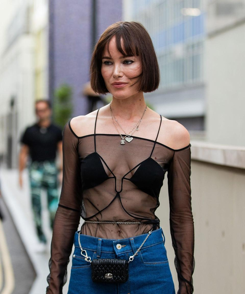 """The blunt cut <a href=""""https://www.refinery29.com/en-gb/2021/08/10646473/bob-haircut-trend-autumn-2021"""" rel=""""nofollow noopener"""" target=""""_blank"""" data-ylk=""""slk:bob"""" class=""""link rapid-noclick-resp"""">bob</a> is reigning supreme. The bitty, full fringe gives this style a '90s feel.<span class=""""copyright"""">Photo by Christian Vierig/Getty Images</span>"""