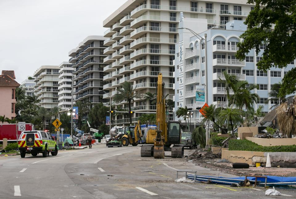 Rubble and debris of the Champlain Towers South condo can be seen in Surfside, Florida on Tuesday, July 6, 2021. The rubble shown here is from the front portion of the condo towers, which was demolished 11 days after the back part of the tower collapsed with people inside. (Matias J. Ocner/Miami Herald via AP)