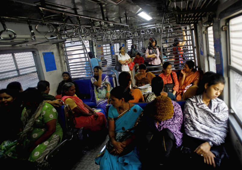 FILE - In this Thursday, Jan. 10, 2013 file photo, Indian women travel in the women's compartment of a train early morning in Mumbai, India. A series of recent high-profile gang rape cases in India has ignited a debate: Are such crimes on the rise, or is it simply that more attention is being paid to a problem long hidden within families and villages? The answer, experts say, is both. Modernization is fueling a crisis of sexual assault in India, with increasingly independent women now working in factories and offices and stepping beyond the subservient roles to which they had traditionally been relegated. (AP Photo/Rafiq Maqbool, File)