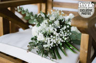 <p>Modody's mom Robin Renee decorated the venue with old driftwood, greenery and flowers — and she also made her new daughter-in-law's bouquet!</p>
