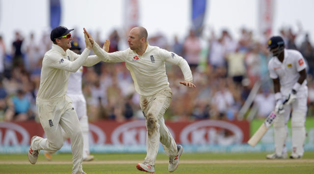 England's Jack Leach celebrates the dismissal of Sri Lanka's Kusal Mendis with teammate Joss Buttler, left, during the fourth day of the first test cricket match between Sri Lanka and England in Galle, Sri Lanka, Friday, Nov. 9, 2018. (AP Photo/Eranga Jayawardena)