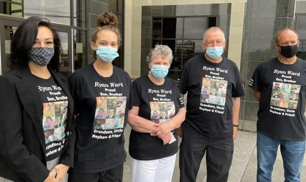 Members of Ryan Ward's family, including sister Jessica Ward, left, niece Fayth Ward, mother Sharlyn Ward, father Fred Ward and biological father Rene Hebert wore shirts with Ward's photo to court for the sentencing hearing on Wednesday morning in Moncton.  (Shane Magee/CBC - image credit)