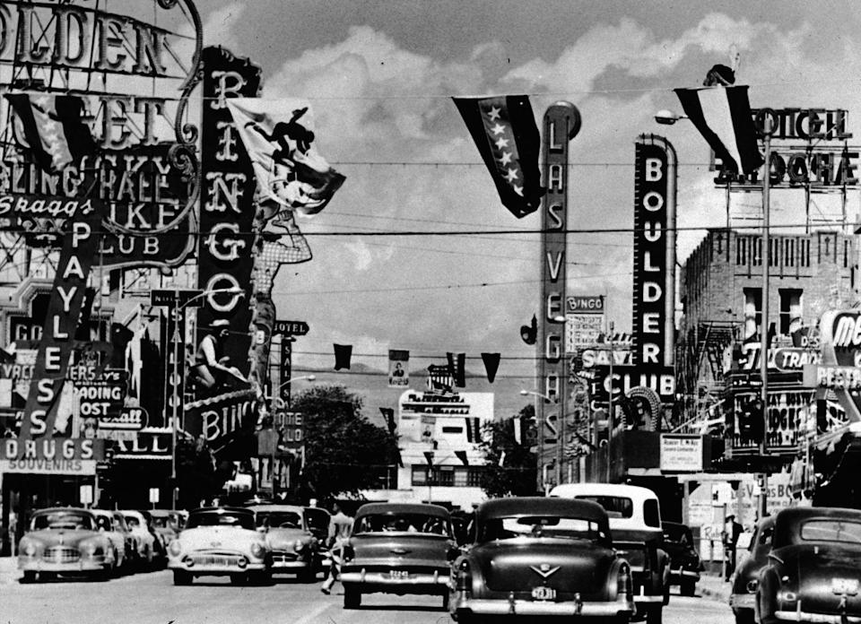 <p>Cars drive down Fremont Street in Las Vegas in 1955. The street was named in honor of explorer John Charles Frémont and is located in the main downtown casino corridor.</p>