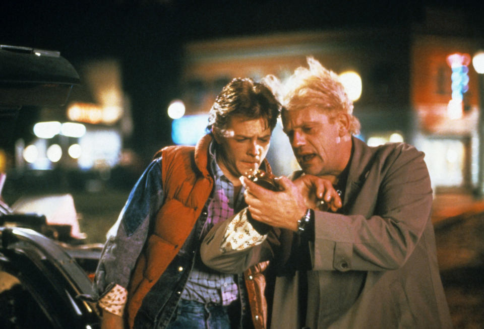 Fox and Christopher Lloyd in <em>Back to the Future</em>. The actor was cast in Robert Zemeckis's blockbuster midway through shooting <em>Teen Wolf</em>. (Photo: Universal Pictures/courtesy Everett Collection)