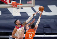 Phoenix Suns forward Frank Kaminsky (8) shoots against New Orleans Pelicans center Willy Hernangomez (9) during the first half of an NBA basketball game in New Orleans, Friday, Feb. 19, 2021. (AP Photo/Gerald Herbert)