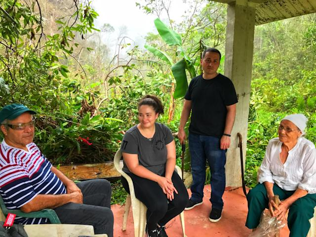 <p>Jesse Vazquez, left, sits with his daughter, Megan, his son, Oscar, and his mother, Mercedes Mercado under the gazebo on their farm in Hatillo, Puerto Rico. Three weeks after Hurricane Maria devastated the island, the family traveled to Hatillo from their home in Bayamon to assess the damage to their property. (Photo: Caitlin Dickson/Yahoo News) </p>