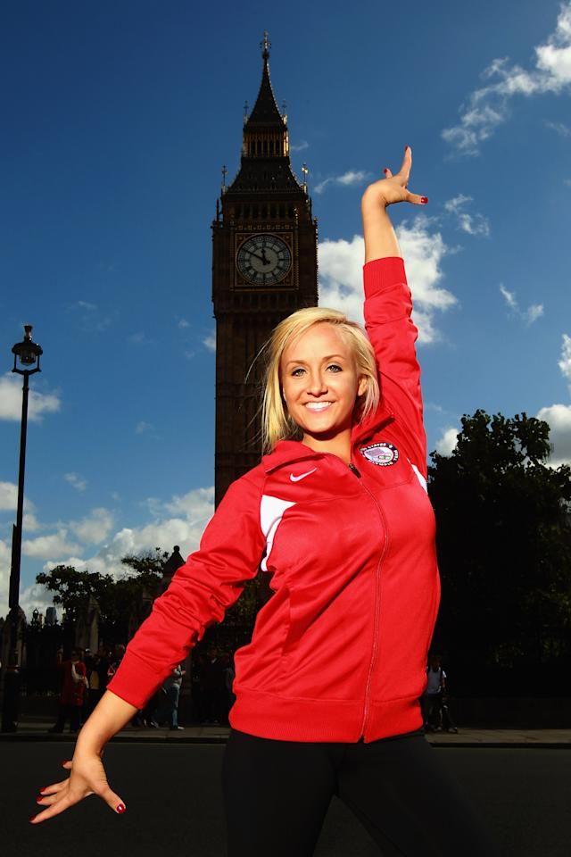 LONDON, ENGLAND - SEPTEMBER 13:  Gymnast Nastia Liukin of the USA poses in front of Big Ben and the Houses of Parliament during a tour of London on September 13, 2011 in London, England.  (Photo by Bryn Lennon/Getty Images for USOC)