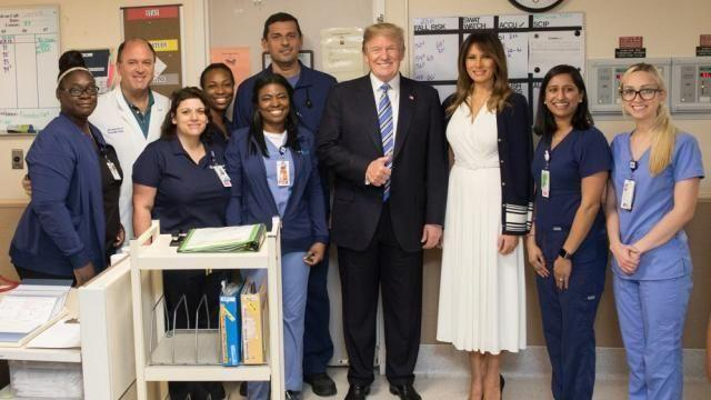 After visiting the Broward County Sheriff's Office, President Trump posed with medics who treated victims of the deadly Parkland school shooting. People are puzzled by his smile. Photo: Donald Trump Twitter