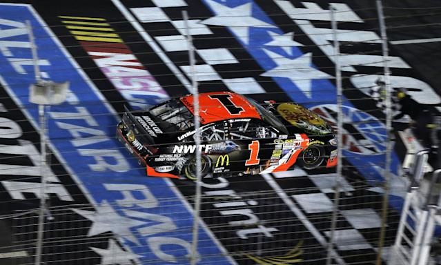 Jamie McMurray (1) takes the checkered flag to win the NASCAR Sprint All-Star auto race at Charlotte Motor Speedway in Concord, N.C., Saturday, May 17, 2014. (AP Photo/Gerry Broome)