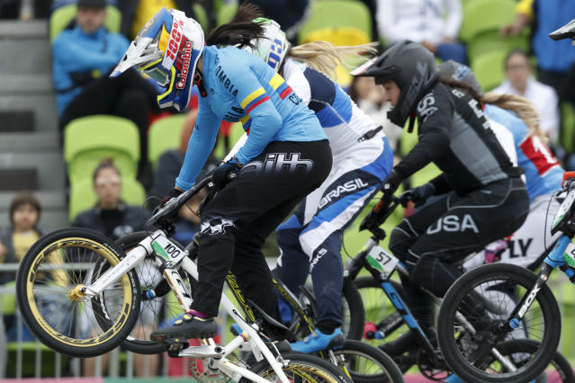 Mariana Pajon of Colombia rides in a women's cycling BMX heat at the Pan American Games in Lima, Peru, Friday, Aug. 9, 2019. (AP Photo/Fernando Llano)