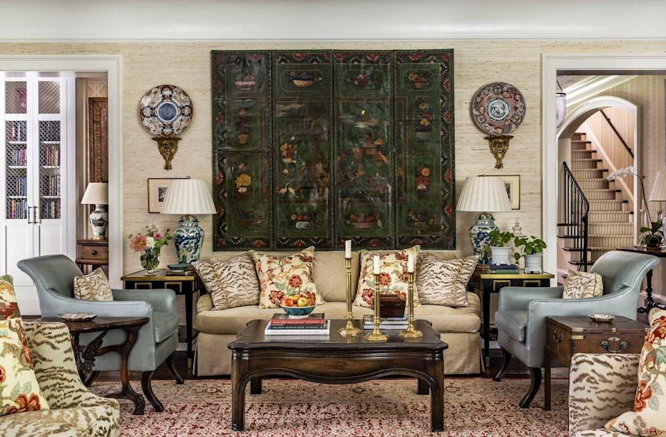 """<p>Using one significant statement pieces, in this case the antique Coromandel screen, establishes a """"base"""" for mixing patterns. Its colors are carried throughout the furnishings, including the rug. </p><p><em>The arrow root wallcovering is <a href=""""https://fschumacher.com/"""" rel=""""nofollow noopener"""" target=""""_blank"""" data-ylk=""""slk:Schumacher"""" class=""""link rapid-noclick-resp"""">Schumacher</a>; the tiger pattern fabric is <a href=""""https://www.cowtan.com/"""" rel=""""nofollow noopener"""" target=""""_blank"""" data-ylk=""""slk:Cowtan & Tout"""" class=""""link rapid-noclick-resp"""">Cowtan & Tout</a>; the floral pattern is Schumacher; the leather is <a href=""""https://www.edelmanleather.com/"""" rel=""""nofollow noopener"""" target=""""_blank"""" data-ylk=""""slk:Edelman"""" class=""""link rapid-noclick-resp"""">Edelman</a>.</em> </p>"""