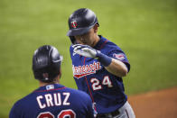 Minnesota Twins Trevor Larnach (24) celebrates with Nelson Cruz after Larnach hit a solo home run during the fifth inning of the team's baseball game against the Texas Rangers in Arlington, Texas, Friday, June 18, 2021. (AP Photo/Andy Jacobsohn)