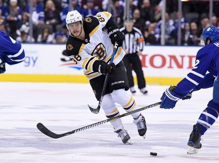 Apr 17, 2019; Toronto, Ontario, CAN; Boston Bruins forward David Pastrnak (88) shoots the puck against Toronto Maple Leafs in game four of the first round of the 2019 Stanley Cup Playoffs at Scotiabank Arena. Mandatory Credit: Dan Hamilton-USA TODAY Sports