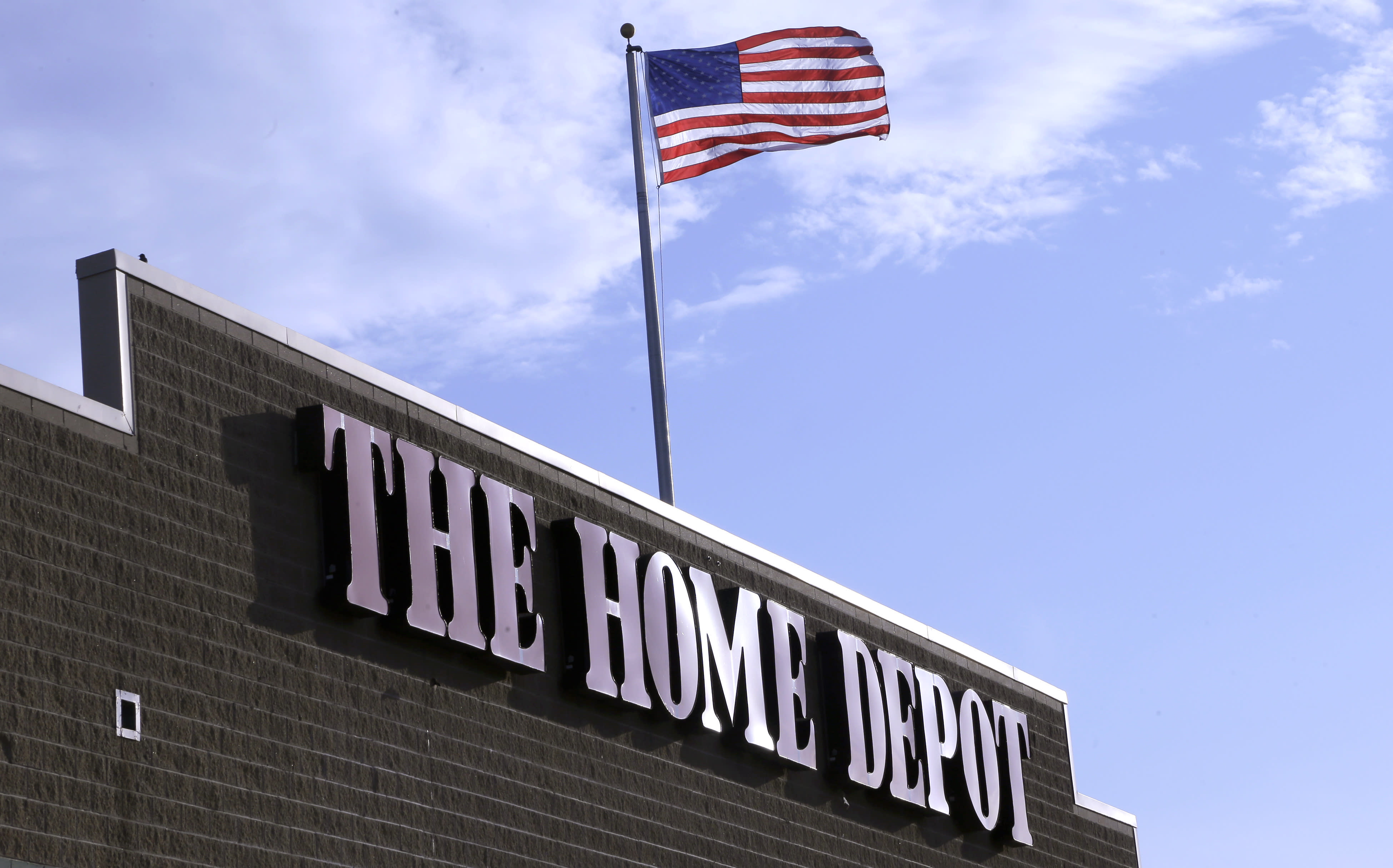 An American flag flies over a Home Depot store location, in Bellingham, Mass. (AP Photo/Steven Senne, File)
