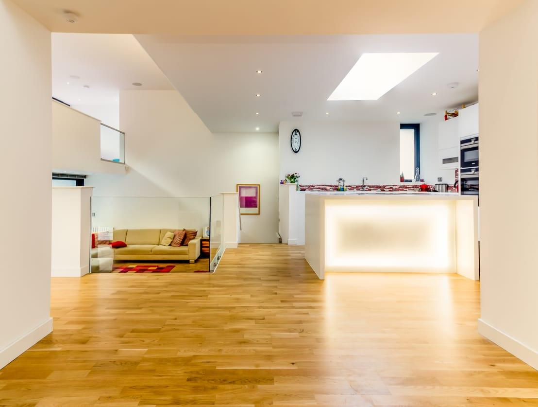 """<p>The new living area is now on the same level as the new entrance, opening up onto the rear<a rel=""""nofollow"""" href=""""https://www.homify.co.uk/rooms/garden"""">garden</a> via a sheltered deck. The new kitchen and dining area are situated above this, on the same level as the existing ground floor.</p>  Credits: homify / Capital A Architecture"""