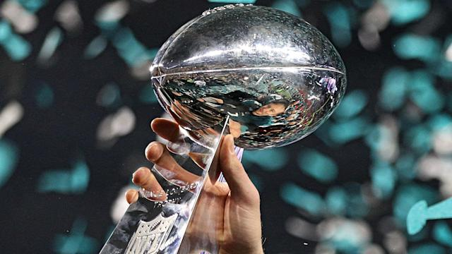 Confetti falls around the first-ever Super Bowl trophy for the Philadelphia Eagles. (Getty)