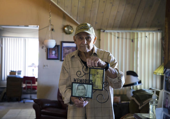 Vincent Randazzo holds a frame containing photos of him and his wife, Rose Violet Randazzo. (Mariana Henninger / NBC News)