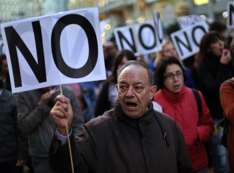 Protestors shout slogans against austerity measures announced by the Spanish government as they march to the Parliament in Madrid, Spain, Saturday, Oct. 27, 2012. Prime Minister Mariano Rajoy's government has hiked taxes, cut spending, including a wage-cut for civil servants, and introduced stinging labor reforms in a bid to persuade investors and international authorities that he can manage Spain's finances without the need for a full-blown bailout. However, Spain's public finances have been overwhelmed by the cost of rescuing some of its banks and regional governments, many of which have experienced heavy losses following a property sector crash in 2008. One Spaniard in four is unemployed as the economic crisis tightens its grip. (AP Photo/Andres Kudacki)