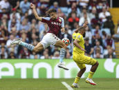 Aston Villa's Matty Cash, left, and Brentford's Bryan Mbeumo battle for the ball during the English Premier League soccer match between Aston Villa and Brentford, at Villa Park, in Birmingham, England, Saturday Aug. 28, 2021. (Barrington Coombs/PA via AP)
