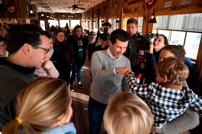Democratic presidential hopeful Pete Buttigieg gets a fist bump from a child at Polly's Pancake Parlor in Franconia, N.H.