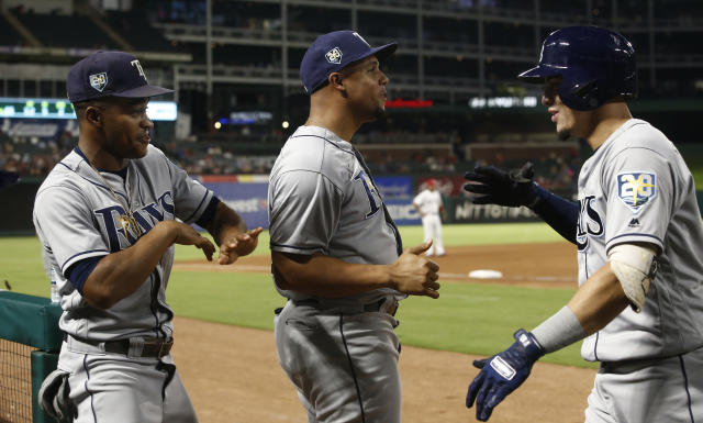 Tampa Bay Rays' Willy Adames, on right, celebrates his two-run home run against the Texas Rangers with Mallex Smith, left, and Carlos Gomez during the fourth inning of a baseball game Wednesday, Sept. 18, 2018, in Arlington, Texas. (AP Photo/Mike Stone)