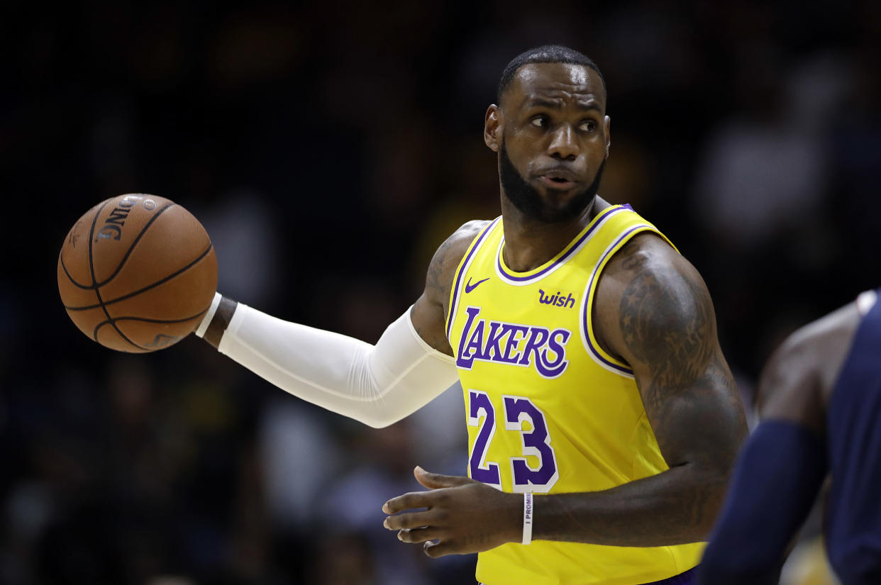 LeBron James showed off his court vision in his Lakers debut. (AP Photo/Gregory Bull)