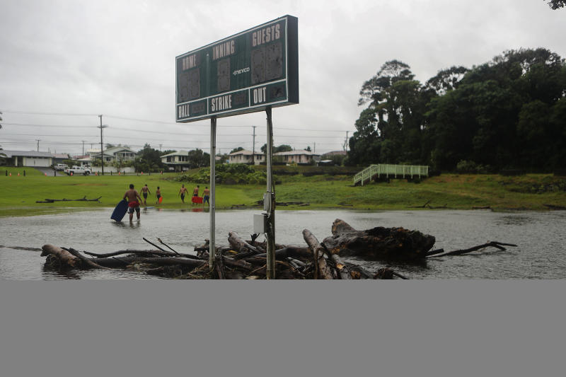 Floodwaters surround a baseball scoreboard during flooding from Tropical Storm Lane on the Big Island, in Hilo, Hawaii. (Mario Tama via Getty Images)