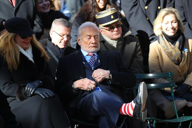 <p>Honorary Grand Marshall Buzz Aldrin shows off his colorful socks during a ceremony before the Veterans Day parade on Fifth Avenue in New York on Nov. 11, 2017. (Photo: Gordon Donovan/Yahoo News) </p>