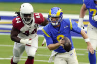Los Angeles Rams quarterback John Wolford, right, is chased by Arizona Cardinals linebacker Markus Golden during the first half of an NFL football game Sunday, Jan. 3, 2021, in Inglewood, Calif. (AP Photo/Ashley Landis)