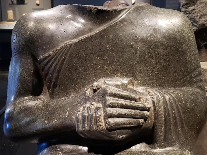 A detail of a statue of Prince Gudea, showing powerful hands.