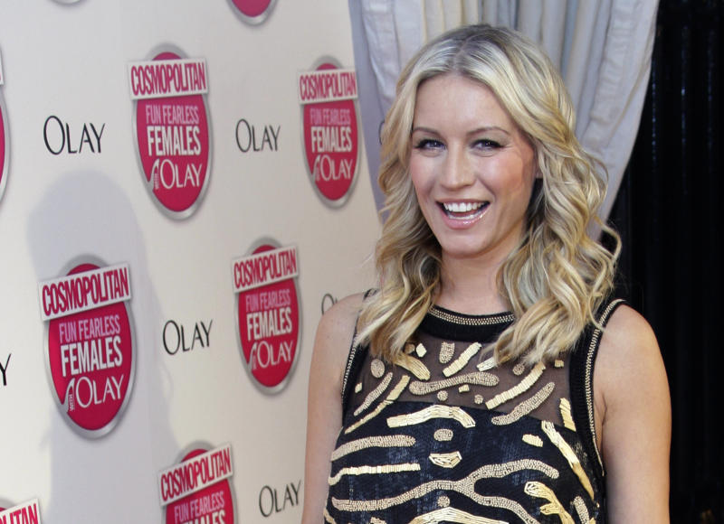 British presenter Denise Van Outen arrives at the Ultimate Women of the Year Awards 2009 in London, Wednesday Nov. 11, 2009. (AP Photo/Joel Ryan)