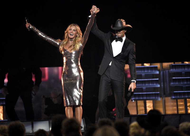 """FILE - In this April 2, 2017 photo, Faith Hill, left, and Tim McGraw appear after a performance of """"Speak To A Girl"""" at the 52nd annual Academy of Country Music Awards in Las Vegas. The country couple with movie star glamour has sold over 63 million albums in the U.S. between their two careers, has earned two Grammys for duets they sang together and has three children. This year, they are releasing their first-ever duet album together and started their third installment of their highly successful Soul2Soul World tour on April 7. (Photo by Chris Pizzello/Invision/AP, File)"""
