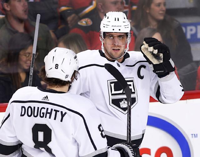 Los Angeles Kings' Anze Kopitar, right, of Slovenia, celebrates his goal with teammate Drew Doughty during the first period of an NHL hockey game against the Calgary Flames on Saturday, Dec. 7, 2019, in Calgary, Alberta. (Larry MacDougal/The Canadian Press via AP)