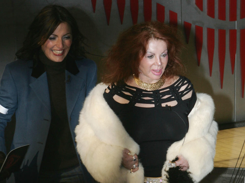 HERTFORDSHIRE, ENGLAND -  JANUARY 14: Celebrity Big Brother III housemate Jackie Stallone and presenter Davina MaCall pose for photographs outside the Big Brother house after Jackie was the first celebrity to be evicted from the house, at Elstree Studios on January 14, 2004 in Hertfordshire, England. (Photo by Gareth Cattermole/Getty Images)