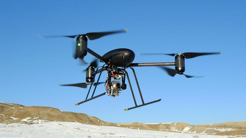 In this Jan. 8, 2009, photo provided by the Mesa County, Colo., Sheriff's Department, a small Draganflyer X6 drone is photographed during a test flight in Mesa County, Colo., with a Forward Looking Infer Red payload. The drone, which was on loan to the sheriff's department from the manufacturer, measures about 36 inches from rotor tip to rotor tip, weights just over two pounds, and has been used for search and rescue mission, to help find suspects, and to identify hot spots after a major fire.  (AP Photo/Mesa County Sheriff's Unmanned Operations Team)