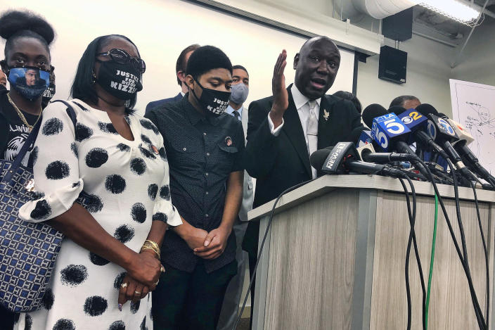 FILE - In this Sept. 22, 2020, file photo, attorney Benjamin Crump speaks alongside members of Dijon Kizzee's family during a news conference in Los Angeles. The family of Kizzee, a Black man who was shot and killed by sheriff's deputies after they tried to detain him for allegedly riding a bicycle illegally, is seeking $35 million in damages from Los Angeles County. Kizzee, 29, was killed Aug. 31, 2020, in South Los Angeles after two deputies tried to stop him for riding a bicycle in the wrong direction. He dropped the bike and ran away, carrying a bundle of clothing that authorities say contained a firearm. (AP Photo/Stefanie Dazio, File)
