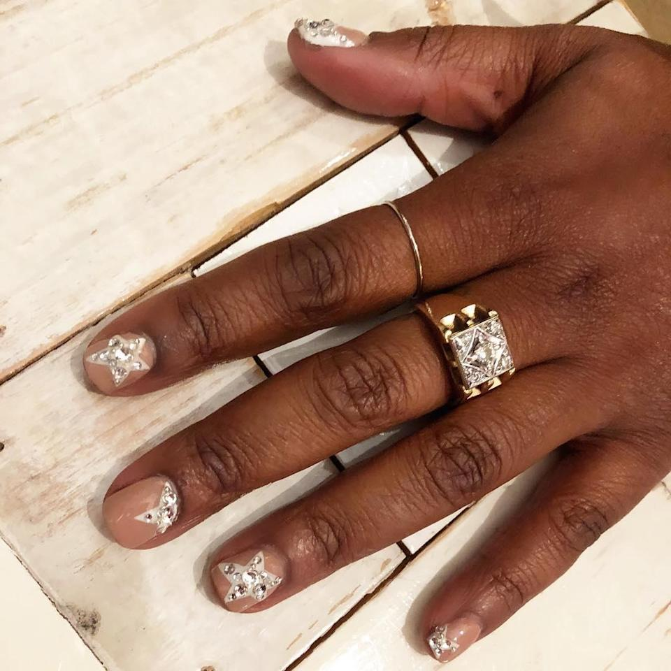 """These blingy stars are perfect for New Year's Eve—even if you'll just be chilling on the couch. Take your stars to the next level with <a href=""""https://www.beyondpolish.com/products/opi-shine-bright-opi-x-swarovski-crystal-kit?variant=32465290788915&utm_medium=cpc&utm_source=google&utm_campaign=Google%20Shopping&gclid=CjwKCAiAnvj9BRA4EiwAuUMDf738h2JhXfek7R05l-zWSqozjoFcPdyBF0FwrjAh9xidpDs-Nx0HRRoCsfsQAvD_BwE"""" rel=""""nofollow noopener"""" target=""""_blank"""" data-ylk=""""slk:this crystal kit"""" class=""""link rapid-noclick-resp"""">this crystal kit</a>."""