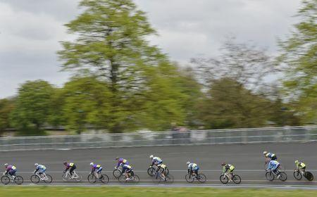 Cyclists compete at a monthly amateur race meet at Herne Hill Velodrome in south London