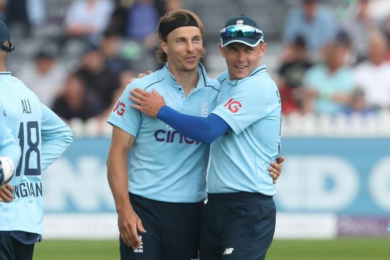 Brothers in arms - England's Tom Curran (L) is congratulated by his brother, Sam (R) after dismissing Sri Lanka's Oshada Fernando in the third ODI at Bristol on Sunday