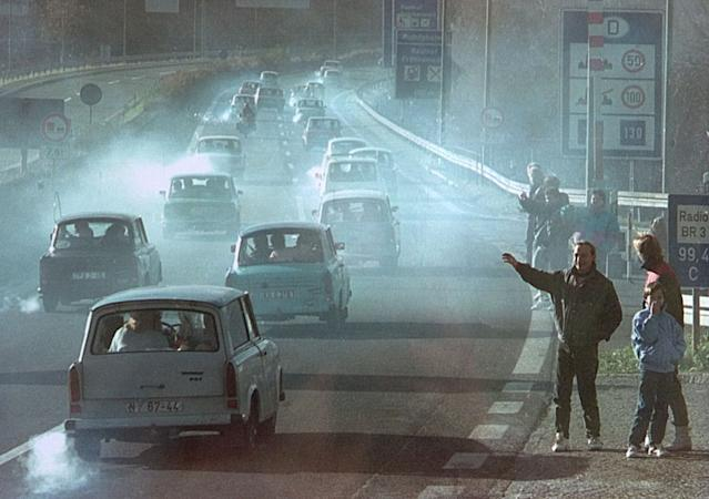 East German Trabant cars make their way past East Germans who had crossed the former Rudolphstein border checkpoint in Bavaria on Nov. 11, 1989. (Photo: Reuters)