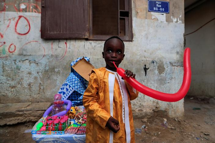 Also in Dakar, this boy was pictured playing with a balloon