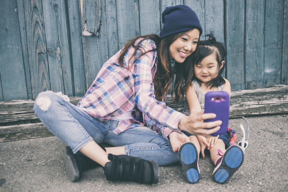 Parents will have shared 1,300 pictures of their children online by the time they are 13 [Photo: Getty]