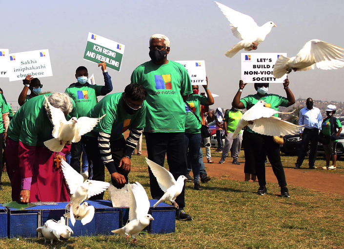White doves are set free at a peace march held in Phoenix, near Durban, South Africa, Tuesday, Sept. 14, 2021 the scene of recent racial tensions and unrest over the jailing of former President Jacob Zuma. The upcoming local elections, set for Nov. 1, 2021, come at a difficult time for the ruling African National Congress which has been struggling with internal divisions. (AP Photo)