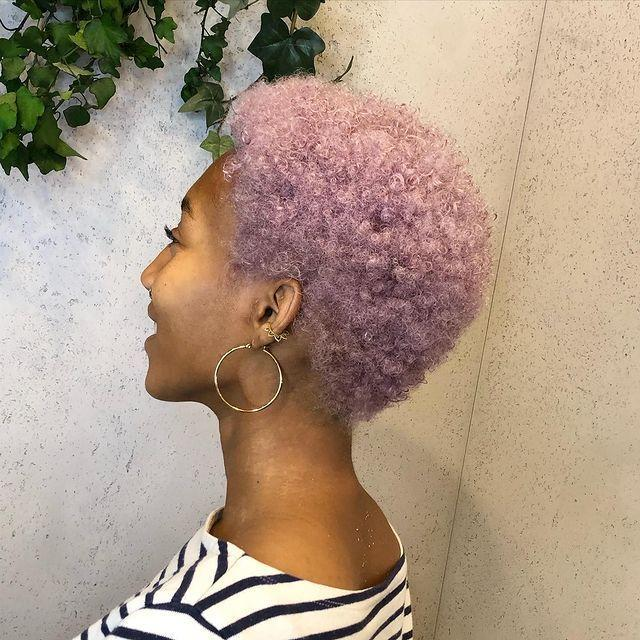 """<p>Coils just add to the coolness of this ashy lilac hue, which has a subtle ombre gradient. </p><p><a href=""""https://www.instagram.com/p/CA96aBMlapG/"""" rel=""""nofollow noopener"""" target=""""_blank"""" data-ylk=""""slk:See the original post on Instagram"""" class=""""link rapid-noclick-resp"""">See the original post on Instagram</a></p>"""